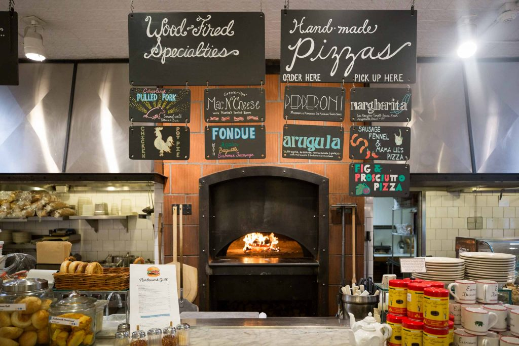 chalkboard signs and brick oven at Elephants Delicatessen at NW 22nd