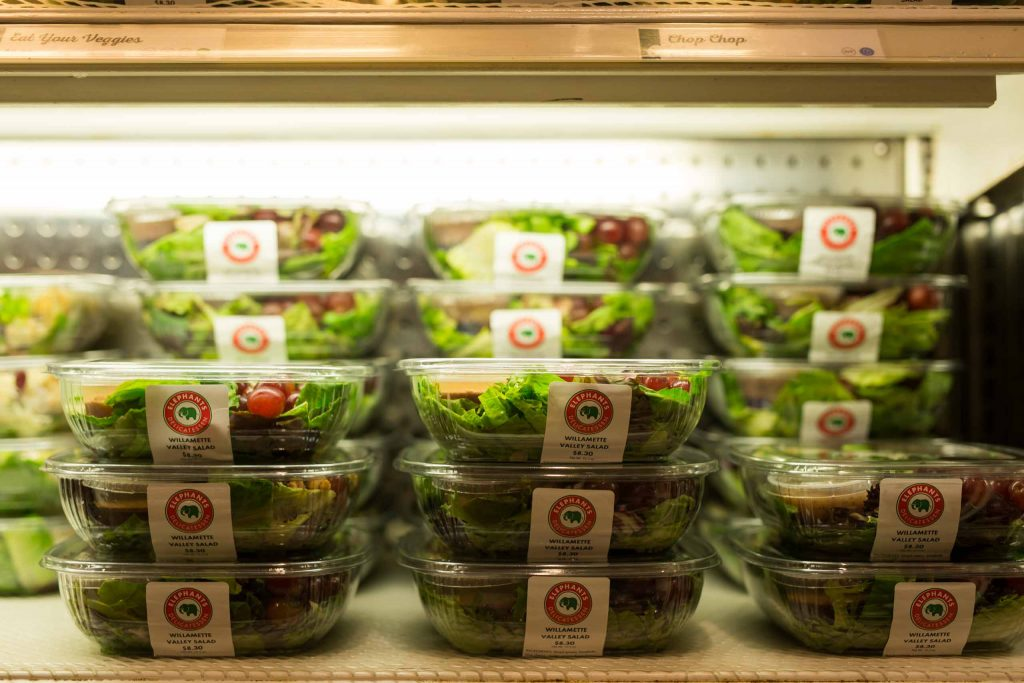 boxed salads in refrigerator case at Elephants Delicatessen at NW 22nd