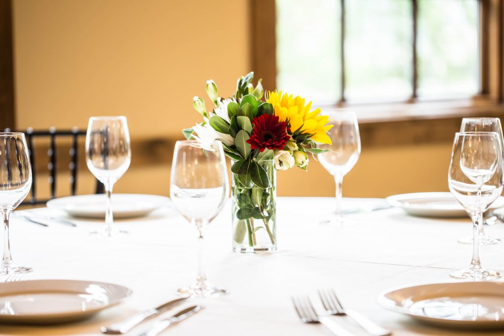 place settings with wine glasses at Elephants Delicatessen Corbett Room event space