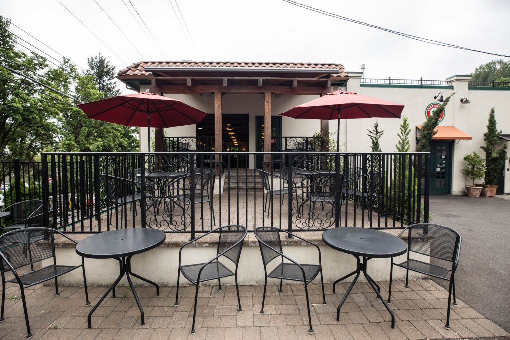 Elephants Delicatessen Corbett Room event space outside patio with tables and chairs