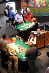 Wild Bills Poker and Blackjack tables with people playing