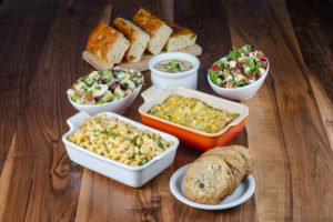 Elephants Delicatessen At Home Dinner Tote with casseroles, cookies, salad, soup, and bread