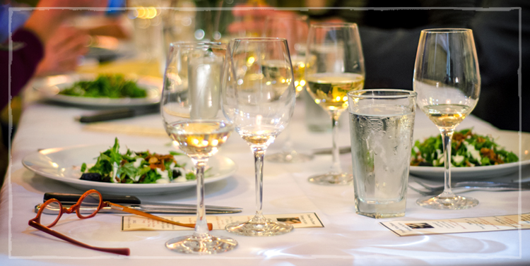 dinner table with white wine in glasses