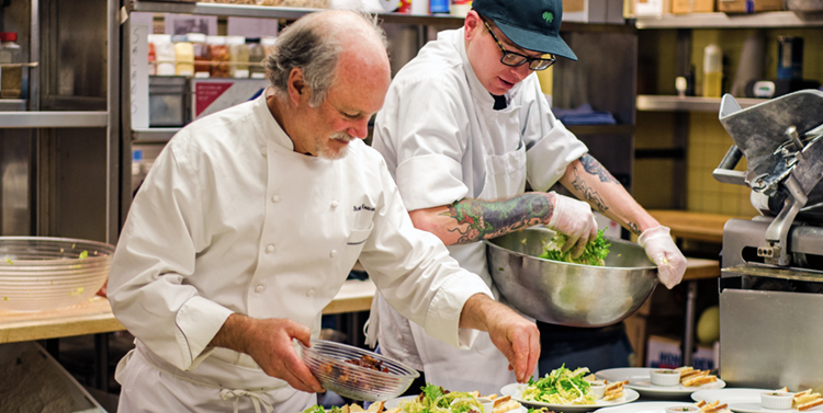 chefs making salads in kitchen