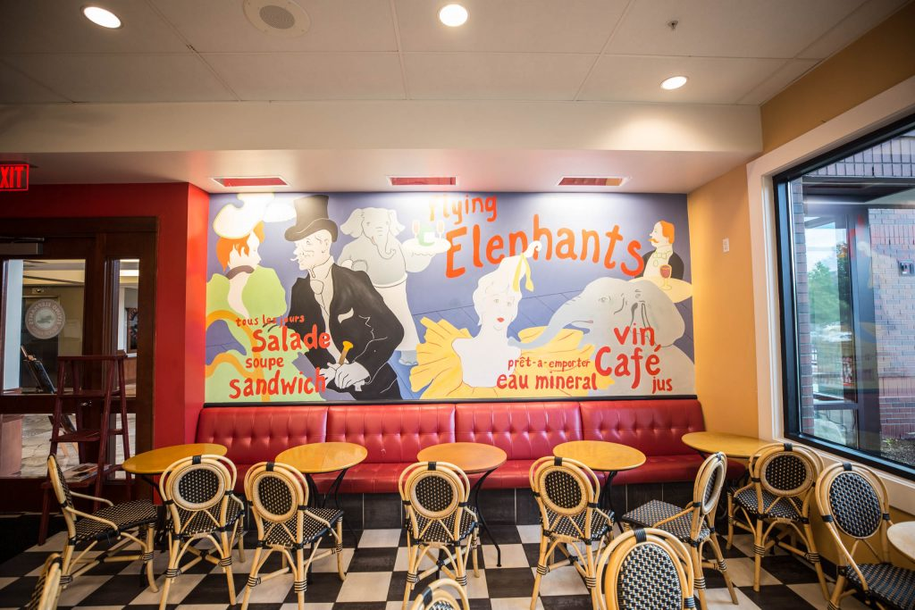 seating and wall artwork with dancing people and elephants at Elephants Delicatessen Kruse Way