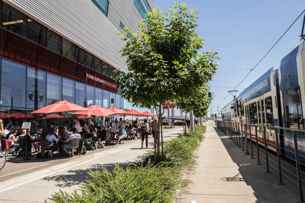 patio and passing train at Elephants Delicatessen South Waterfront