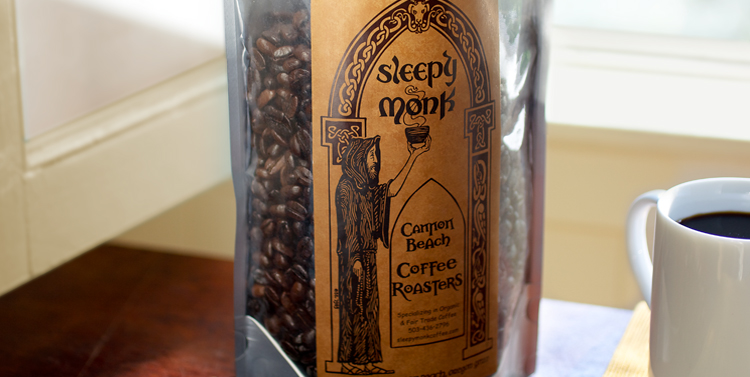 Sleepy Monk coffee roasters bag of coffee beans with coffee cup