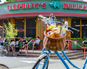 bike with a picnic basket in front of Elephants Delicatessen at NW 22nd