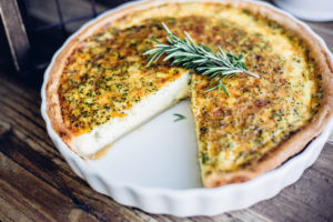 Quiche with one slice cut out